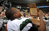 26 Nov. 2011 -- ST. LOUIS -- Staley High School football player Morgan Steward (89, his normal 36 was torn during play) closely examines the MSHSAA Class 5 state championship football trophy after kissing during the celebration after the Falcons beat Kirkwood High School at the Edward Jones Dome in St. Louis Saturday, Nov. 26, 2011. Photo © copyright 2011 Sid Hastings.