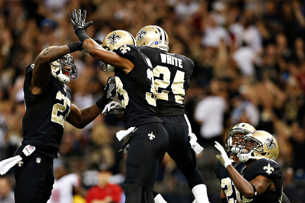 NEW ORLEANS, LA - NOVEMBER 11:  Corey White #24, Malcolm Jenkins #27 and Jabari Greer #33 of the New Orleans Saints celebrate after a touchdown against the Atlanta Falcons at Mercedes-Benz Superdome on November 11, 2012 in New Orleans, Louisiana.  The Saints defeated the Falcons 31-27.  (Photo by Wesley Hitt/Getty Images) *** Local Caption *** Corey White; Jabari Greer; Malcolm Jenkins