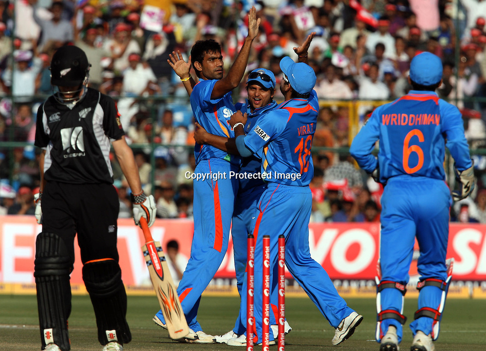 Indian bowler Munaf Patel celebrates with team mates New Zeland batsman Kane Williamson wicket during the 2nd ODI india vs New Zealand Played at Sawai Mansingh Stadium, Jaipur, 1 December 2010 - day/night (50-over match)
