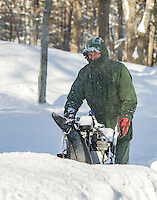 Everett Houston snow blows his driveway in Laconia following Thursday nights nor'easter.  (Karen Bobotas/for the Laconia Daily Sun)