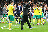 Picture by Paul Chesterton/Focus Images Ltd.  07904 640267.31/03/12.Norwich Manager Paul Lambert applauds the traveling support at the end of the Barclays Premier League match at Craven Cottage stadium, London.