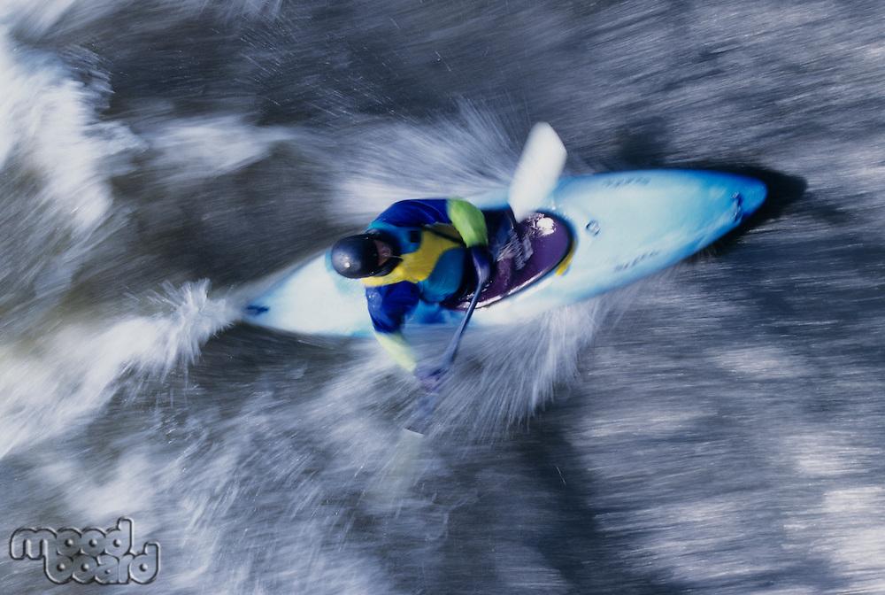 Kayaker paddling through Rapids overhead view