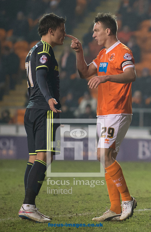 Anthony McMahon of Blackpool (right) squares up to Jelle Vossen of Middlesbrough during the Sky Bet Championship match at Bloomfield Road, Blackpool<br /> Picture by Russell Hart/Focus Images Ltd 07791 688 420<br /> 10/02/2015