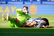Marcus Bettinelli of Fulham and Jacob Murphy of Sheffield Wednesday clash causing a head injury to Jacob Murphy during the EFL Sky Bet Championship match between Sheffield Wednesday and Fulham at Hillsborough, Sheffield, England on 21 September 2019.