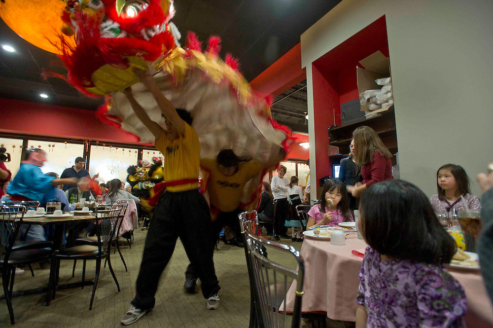 Families celebrate the Chinese Lunar New Year at Hollywood East Cafe in Wheaton, Maryland.  Photography by Johnny Bivera