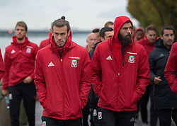 VIENNA, AUSTRIA - Thursday, October 6, 2016: Wales' Gareth Baleand Joe Ledley lead the Wales team during a pre-match walk at the Hilton Danube Waterfront Hotel ahead of the 2018 FIFA World Cup Qualifying Group D match against Austria. (Pic by Peter Powell/Propaganda)