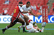 JOHANNESBURG, South Africa, 02 April 2011. Will Genia of the Reds kicks ahead with Edgar Marutlulle of the Lions trying to stop him during the Super15 Rugby match between the Lions and the Reds at Coca-Cola Park in Johannesburg, South Africa on 02 April 2011. .Photographer : Anton de Villiers / SPORTZPICS