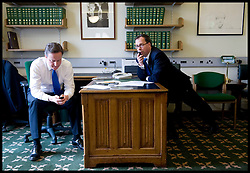 David Cameron Texting on his mobile phone in his office in Norman Shaw South with his Chief of Staff Ed Llewellyn, as he waits for news with members of his staff as they watch Gordon Brown resign as Prime Minister, Tuesday May 11, 2010,  Photo By Andrew Parsons / i-Images