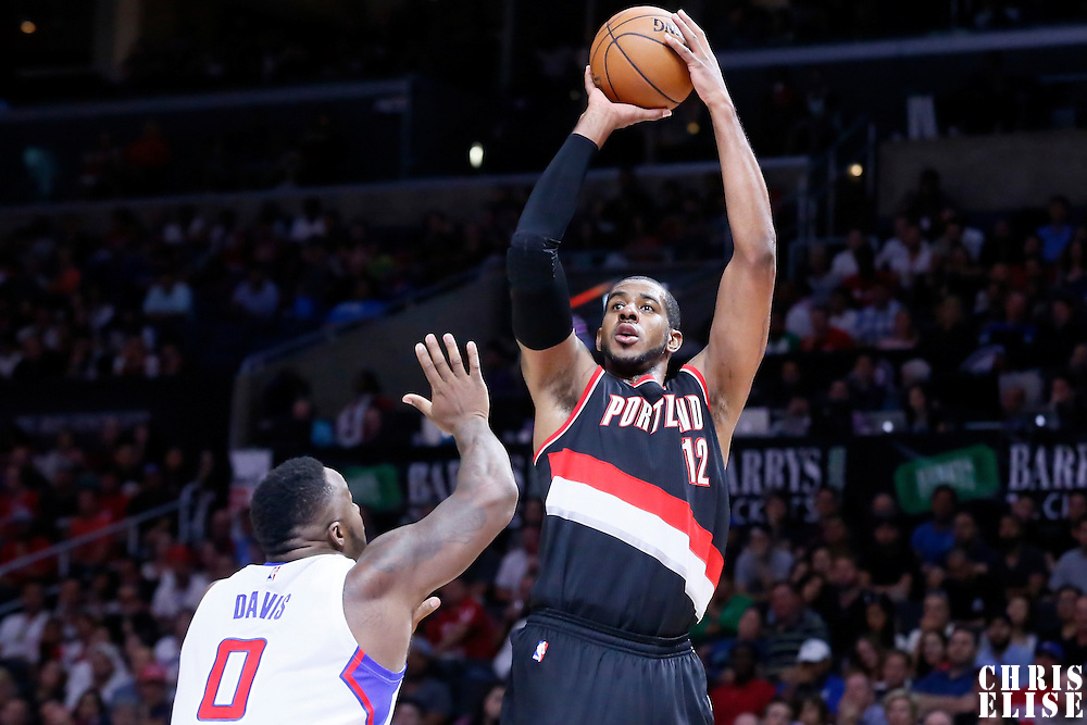 08 November 2014: Portland Trail Blazers forward LaMarcus Aldridge (12) takes a jump shot over Los Angeles Clippers forward Glen Davis (0) during the Los Angeles Clippers 106-102 victory over the Portland Trail Blazers, at the Staples Center, Los Angeles, California, USA.