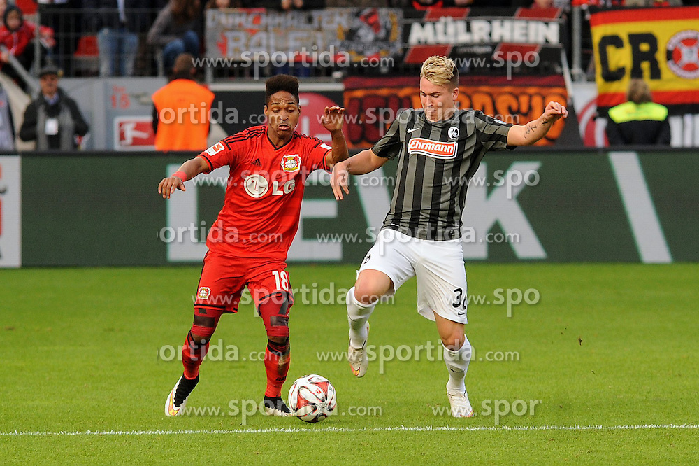 28.02.2015, BayArena, Leverkusen, GER, 1. FBL, Bayer 04 Leverkusen vs SC Freiburg, 23. Runde, im Bild Wendell ( links Bayer 04 Leverkusen ) im Zweikampf mit Felix Klaus ( rechts SC Freiburg ) // during the German Bundesliga 23rd round match between Bayer 04 Leverkusen and SC Freiburg at the BayArena in Leverkusen, Germany on 2015/02/28. EXPA Pictures &copy; 2015, PhotoCredit: EXPA/ Eibner-Pressefoto/ Thienel<br /> <br /> *****ATTENTION - OUT of GER*****