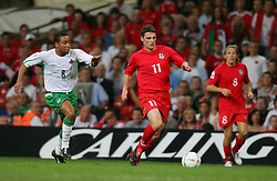 CARDIFF, WALES - Wednesday, September 8, 2004: Wales' Jason Koumas in action against Northern Ireland's Jeff Whitley during the Group Six World Cup Qualifier at the Millennium Stadium. (Pic by David Rawcliffe/Propaganda)