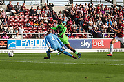 Forest Green Rovers Reuben Reid(26) rounds Northampton Town goalkeeper David Cornell(1) and scores, 0-1 during the EFL Sky Bet League 2 match between Northampton Town and Forest Green Rovers at Sixfields Stadium, Northampton, England on 13 October 2018.