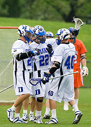 Duke midfielder Ned Crotty (22) celebrates with Duke attackman Matt Danowski (40) after a Duke goal.  The #2 ranked Duke Blue Devils defeated the #3 ranked Virginia Cavaliers 11-9 in the finals of the Men's 2008 Atlantic Coast Conference tournament at the University of Virginia's Klockner Stadium in Charlottesville, VA on April 27, 2008.