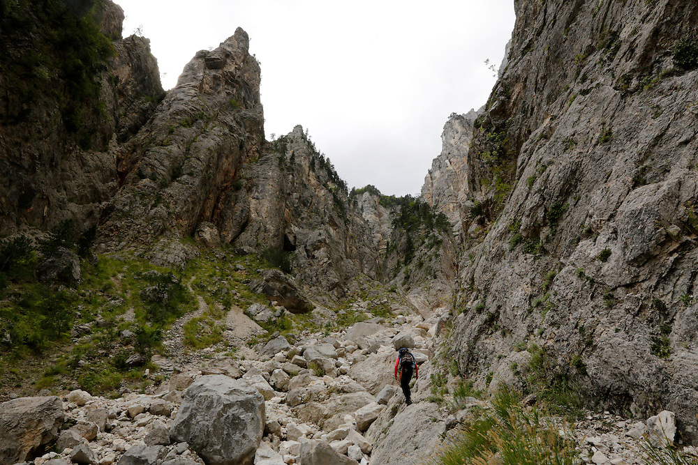 Kenan Muftic, Bosnian alpinist climbing the via ferata below Veliki Kuk, to check on the condition of a stranded hiker, Cvrsnica mountain, Bosnia and Herzegovina.