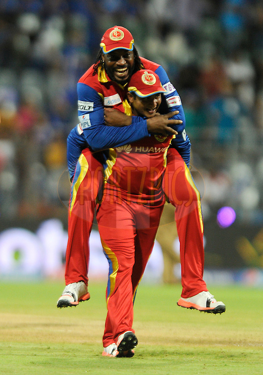 Sarfaraz Naushad Khan of Royal Challengers Bangalore carries Chris Gayle of Royal Challengers Bangalore out of the ground as they celebrate after winning match 46 of the Pepsi IPL 2015 (Indian Premier League) between The Mumbai Indians and The Royal Challengers Bangalore held at the Wankhede Stadium in Mumbai, India on the 10th May 2015.<br /> <br /> Photo by:  Pal Pillai / SPORTZPICS / IPL