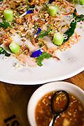 Moo manow, KUROBUTA PORK LOIN SALAD: Preserved Meyer lemon and Asian broccoli in a chili-lime dressing at Issaya Siamese Club