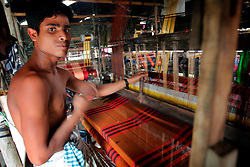 BANGLADESH SIRAJGANJ RADHUNIBARI 30JAN07 - A weaver toils at his handloom in a rural sweatshop in Sirajganj. Records of an indigenous weaving industry based on handlooms producing cotton fabrics date back to the 13th century in this area...jre/Photo by Jiri Rezac..© Jiri Rezac 2007..Contact: +44 (0) 7050 110 417.Mobile:  +44 (0) 7801 337 683.Office:  +44 (0) 20 8968 9635..Email:   jiri@jirirezac.com.Web:    www.jirirezac.com..© All images Jiri Rezac 2007 - All rights reserved.