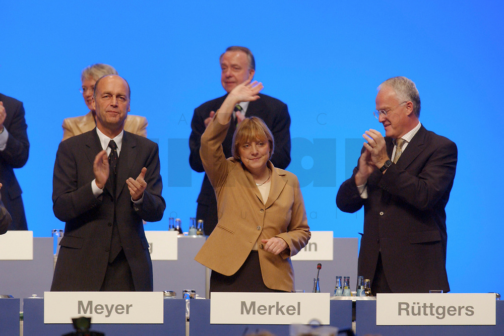 11 NOV 2002, HANNOVER/GERMANY:<br /> Angela Merkel, CDU Bundesvorsitzende, nimmt nach ihrer Rede den Jubel der Delegierten entgegen, links: Laurenz Meyer, CDU Generalsekretaer, rechts: Juergen Ruettgers, CDU Landesvors. NRW, CDU Bundesparteitag, Hannover Messe<br /> IMAGE: 20021111-01-067<br /> KEYWORDS: Parteitag, party congress, speech, Applaus, J&uuml;rgen R&uuml;ttgers