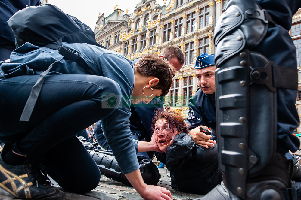 May 26, 2019 - Brussels, North Brabant, Belgium - A yellow vest is seen lying on the floor while being arrested during the protest..Hundreds of yellow vests from different parts of Europe protested against the EU parliament during the EU elections, at the Brussels North station. The riot police showed up and clashed with the demonstrators. (Credit Image: © Ana Fernandez/SOPA Images via ZUMA Wire)