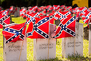 Confederate rebel flags decorate grave markers of soldiers killed in the US Civil War during Confederate Memorial Day at Magnolia Cemetery April 10, 2014 in Charleston, SC. Confederate Memorial Day honors the approximately 258,000 Confederate soldiers that died in the American Civil War.