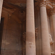 "Petra is a famous archaeological site in Jordan's southwestern desert. Dating to around 300 B.C., it was the capital of the Nabatean Kingdom. Accessed via a narrow canyon called Al Siq, it contains tombs and temples carved into pink sandstone cliffs, earning its nickname, the ""Rose City."" Perhaps its most famous structure is Al Khazneh, a temple with an ornate, Greek-style facade."