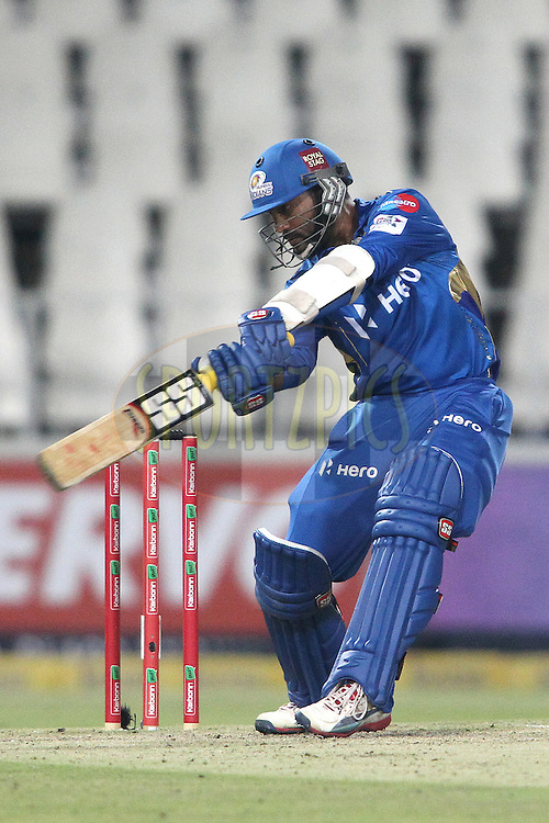 Dinesh Karthik of the Mumbai Indians cuts a delivery during match 13 of the Karbonn Smart CLT20 South Africa between The Chennai Superkings and The Mumbai Indians held at The Wanderers Stadium in Johannesburg, South Africa on the 20th October 2012..Photo by Shaun Roy/SPORTZPICS/CLT20
