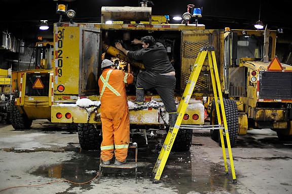 Ian Stewart/Yukon News<br /> Elvis Wolki and George Hohn repair a blower at the Eagle Plains garage. <br /> <br />  &copy; 2013 IAN STEWART PHOTOGRAPHY