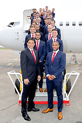 CARDIFF, WALES - Saturday, June 4, 2016: Wales' manager Chris Coleman and captain Ashley Williams stop for a group photograph on the steps on the plane at Cardiff Airport as the squad head to Sweden for their last friendly before the UEFA Euro 2016 in France. (Pic by David Rawcliffe/Propaganda)