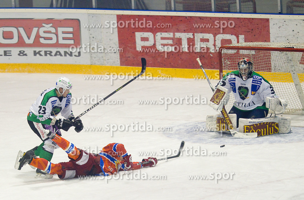 during ice hockey match between HK Acroni Jesenice and  HDD Tilia Olimpija Ljubljana at 33rd Round of EBEL league, on January 1, 2011 in Arena Podmezakla, Jesenice, Slovenia. (Photo By Vid Ponikvar / Sportida.com)