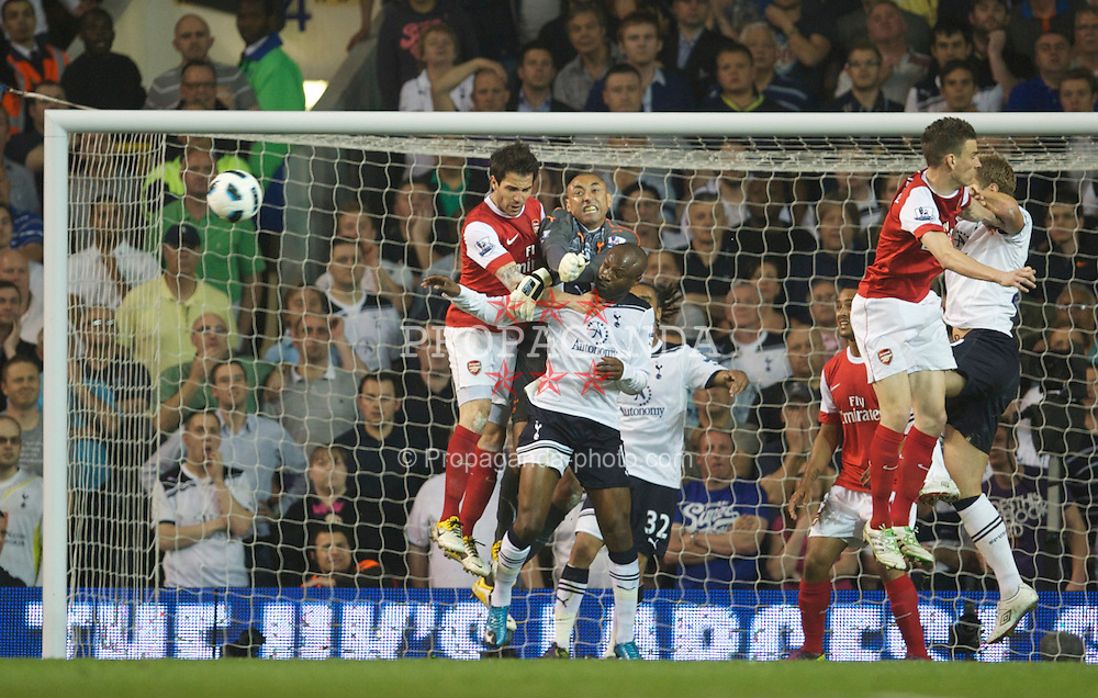 LONDON, ENGLAND - Wednesday, April 20, 2011: Tottenham Hotspur's goalkeeper Heurelho da Silva Gomes and Arsenal's Cesc Fabregas during the Premiership match at White Hart Lane. (Photo by David Rawcliffe/Propaganda)