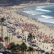 Sunbathers on Ipanema Beach, Rio de Janeiro, looking towards Arpoador point, Rio de Janeiro,  Brazil. 29th July 2010. Photo Tim Clayton..
