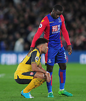 Football - 2016 / 2017 Premier League - Crystal Palace vs. Arsenal<br /> <br /> Jeffrey Schlupp of Palace consoles Alex Oxlade Chamberlain after the final whistle at Selhurst Park.<br /> <br /> COLORSPORT/ANDREW COWIE