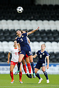 Caroline Weir (#9) of Scotland leaps to win a header during the 2019 FIFA Women's World Cup UEFA Qualifier match between Scotland Women and Switzerland at the Simple Digital Arena, St Mirren, Scotland on 30 August 2018.