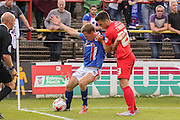 Carlisle United defender Tom Miller hold off York City forward, on loan from Oldham Athletic, Rhys Turner during the Sky Bet League 2 match between York City and Carlisle United at Bootham Crescent, York, England on 19 September 2015. Photo by Simon Davies.