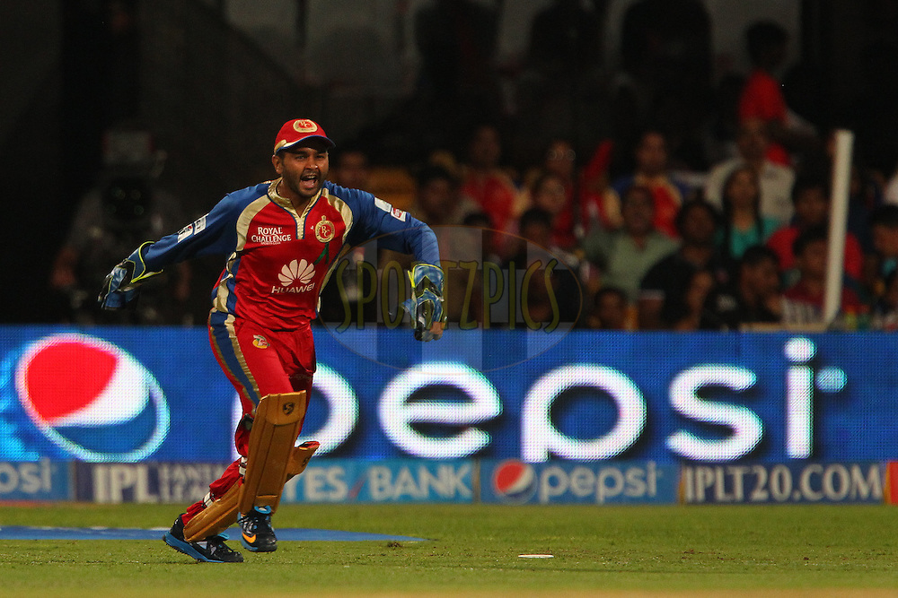 Parthiv Patel of the Royal Challengers Bangalore celebrates the wicket of Aaron Finch of the Sunrisers Hyderabad during match 24 of the Pepsi Indian Premier League Season 2014 between the Royal Challengers Bangalore and the Sunrisers Hyderabad held at the M. Chinnaswamy Stadium, Bangalore, India on the 4th May  2014<br /> <br /> Photo by Ron Gaunt / IPL / SPORTZPICS<br /> <br /> <br /> <br /> Image use subject to terms and conditions which can be found here:  http://sportzpics.photoshelter.com/gallery/Pepsi-IPL-Image-terms-and-conditions/G00004VW1IVJ.gB0/C0000TScjhBM6ikg
