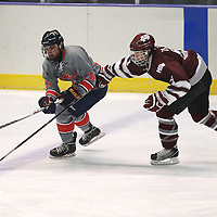 Lauren Wood | Buy at photos.djournal.com<br /> Ole Miss forward Austin Graf battles for the puck with Mississippi State forward Nick Clark during Wednesday night's game at the BancorpSouth Arena.