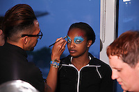 Models prepare backstage at the Erickson Beamon fashion show during Mercedes-Benz Fasion Week in New York on September 11, 2011