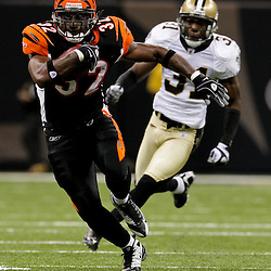 2009 August 14: Cincinnati Bengals running back Cedric Benson (32) runs away from safety Pierson Prioleau (31) during a preseason opener between the Cincinnati Bengals and the New Orleans Saints at the Louisiana Superdome in New Orleans, Louisiana.