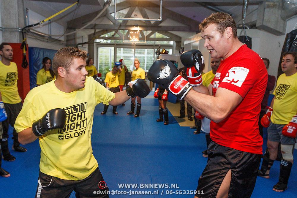 NLD/Amsterdam\/20131025 -Kickboxclinic van Sem Schilt, met Jaap Reesema