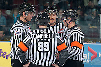 KELOWNA, CANADA - MARCH 28: On ice officials Bevan Mills, linesman, Mike Campbell, referee, Nathan Van Oosten, linesman and Adam Byblow, referee stand at centre ice at the start of game 5 of the first round of WHL playoffs between the Tri-City Americans and the Kelowna Rockets on March 28, 2014 at Prospera Place in Kelowna, British Columbia, Canada.   (Photo by Marissa Baecker/Shoot the Breeze)  *** Local Caption *** Bevan Mills; Mike Campbell; Nathan Van Oosten; Adam Byblow;