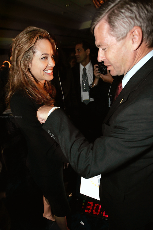 The Prime Minister of Norway, Kjell Magne Bondevik meets actress and activist Angelina Jolie during a panel discussion at the inauguration meeting of the Clinton Global Initiative forum.