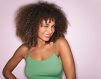 Woman with Curly Hair winking in studio half-length