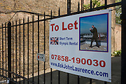 A To Let sign attached to the gate of a building offering space near to the 2012 Olympic Park site.