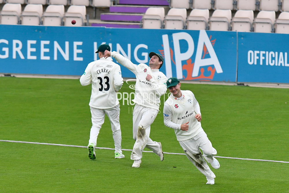 Daryl Mitchell of Worcestershire throws the ball from the boundary rope after chasing it to prevent a boundary during the Specsavers County Champ Div 1 match between Hampshire County Cricket Club and Worcestershire County Cricket Club at the Ageas Bowl, Southampton, United Kingdom on 13 April 2018. Picture by Graham Hunt.