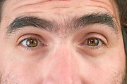 Close up of a man's face with eyes wide open