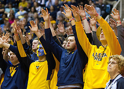 Jan 18, 2017; Morgantown, WV, USA; West Virginia Mountaineers students pause during a foul shot during overtime against the Oklahoma Sooners at WVU Coliseum. Mandatory Credit: Ben Queen-USA TODAY Sports