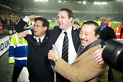 CARDIFF, WALES - Tuesday, January 24, 2012: Cardiff City's owners owner and Chairman Datuk Chan Tien Ghee (L) and owner Tan Sri Vincent Tan Chee Yioun celebrates with manager Malky Mackay after their side's penalty shoot-out victory over Crystal Palace during the Football League Cup Semi-Final 2nd Leg at the Cardiff City Stadium. (Pic by David Rawcliffe/Propaganda)