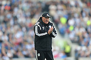 Cardiff City first team mamager Russell Slade applauds during the Sky Bet Championship match between Brighton and Hove Albion and Cardiff City at the American Express Community Stadium, Brighton and Hove, England on 3 October 2015.
