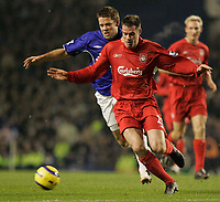 Photo: Dave Howarth.<br /> Everton v Liverpool. The Barclays Premiership. 28/12/2005.  James Beatie battles with Jamie Carragha
