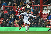 Middlesbrough Forward, Britt Assombalonga (9) challenges Brentford Defender, John Egan (14) during the EFL Sky Bet Championship match between Brentford and Middlesbrough at Griffin Park, London, England on 17 March 2018. Picture by Adam Rivers.